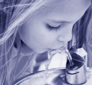 Girl drinking from fountain